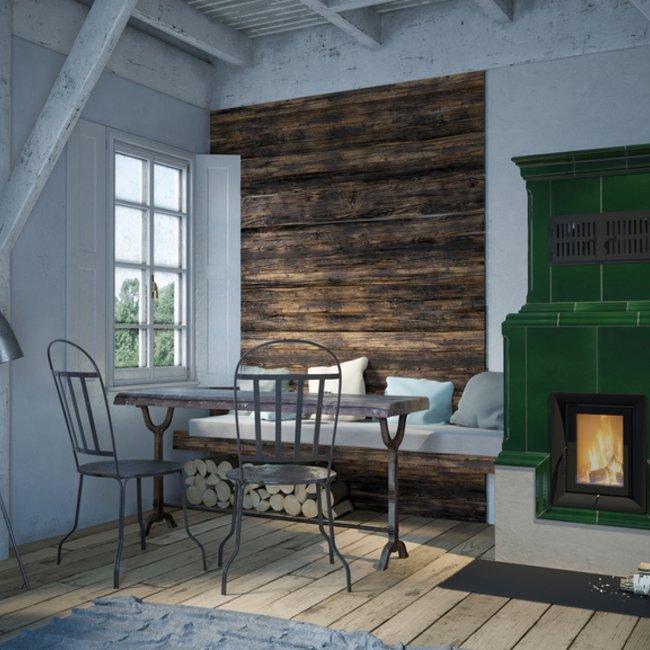 Ein Kachelofen bringt angenehme und gesunde Wärme in den Raum.
