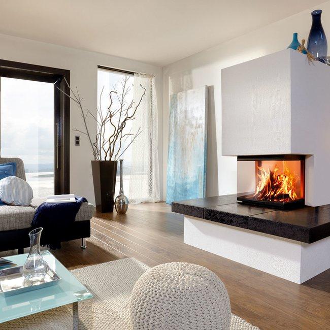 Ein Heizkamin sorgt für ein besonderes Ambiente im Raum und erwärmt den Raum wirtschaftlich.
